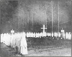 An extremely rare view of a Ku Klux Klan meeting at night in Union County, Arkansas, in the 1920s. The Klan's resurgence in the 1920s partially stemmed from their role as the extreme militant wing of the temperance movement. In the lawless oil boomtowns they often functioned as vigilantes against vice. Photo courtesy of the Arkansas Museum of Natural Resources, Smackover.