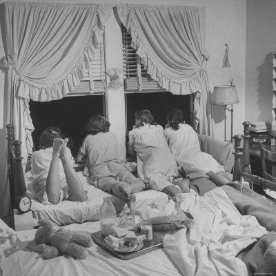 Teenage girls in the '50s talking to boys downstairs at a sleepover - LIFE photograph