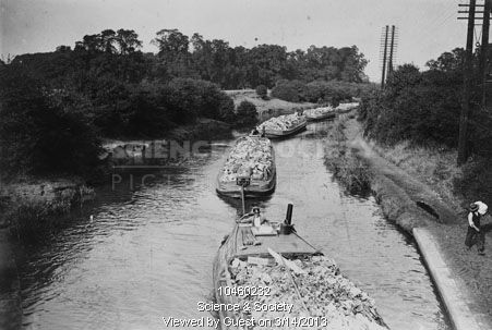 """Caption: """"A train of H.Sabey & Co. Wideboats, filled with London's refuse being towed by a company tug (out of shot), somewhere near Greenford on the Paddington Arm of the Grand Union Canal. 15 September 1933"""" #london #canal #middlesex #paddington #arm  #tug #barge #wideboat #rubbish #refuse #garbage #gravel #pit #hillingdon #hayes #sabey #train #tow"""