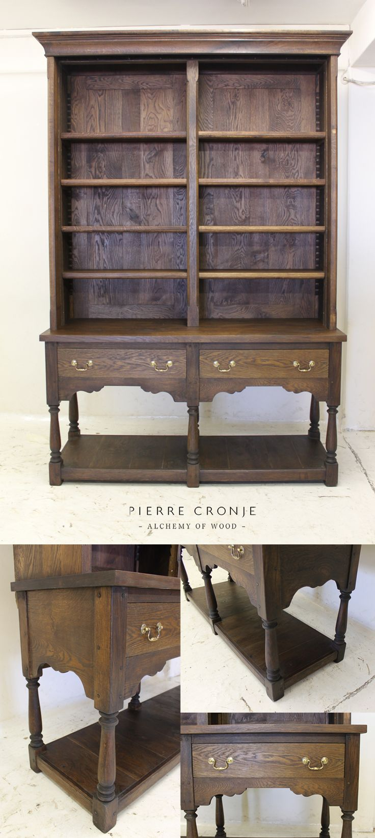 A Pierre Cronje Artois Bookcase in French Oak with antique brass hardware.  The unit also comes with a sliding ladder