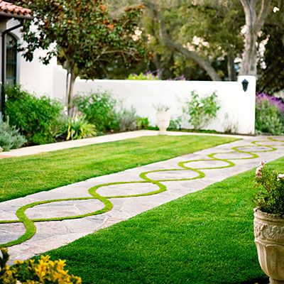 'TifSport' Bermuda grass weaves a double helix in this flagstone walkway. sunset.com