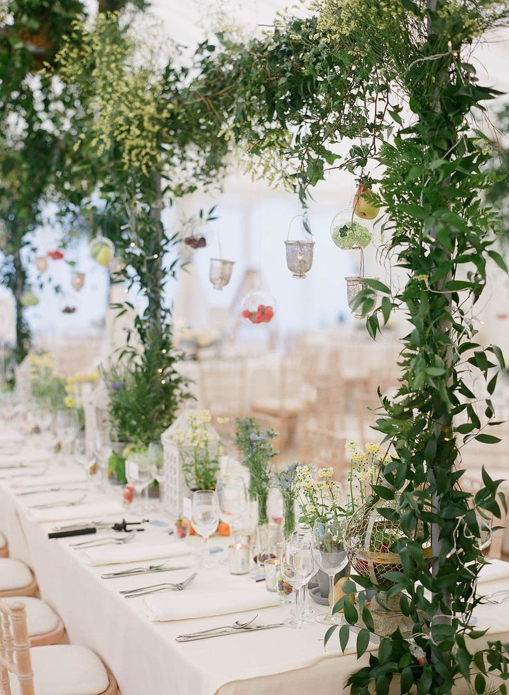 The tabletop designed by Laura Lee Flowers, with hanging tea lights from a trellis wrapped in greenery. The whole effect was romantic and ethereal.