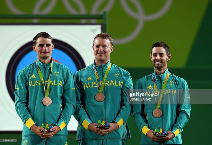 Alec Potts, Ryan Tyack and Taylor Worth of Australia celebrate with their bronze medals in the medal ceremony after finishing third during the Rio 2016 Olympic Games Men's Team completion at the Sambodromo archery venue in Rio de Janeiro, Brazil on August 6, 2016. / AFP / Jewel SAMAD