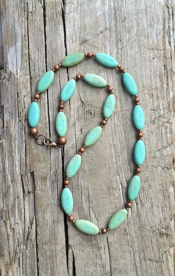 "Beautiful green blue turquoise magnesite oval stones with a hint of brown combined with copper accents give this necklace a nice rustic, boho vibe. This necklace is 18"" in length as shown but can be a"