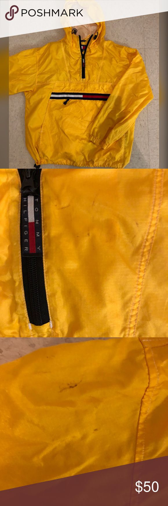 Vintage Tommy Hilfiger rain jacket In good condition has a couple slight stains on it shown in pictures but hardly noticeable when being worn. Haven't tried to hard to get them out but it's priced due to the stains so if you get it out yourself it's basically a steal. Tommy Hilfiger Jackets & Coats Raincoats
