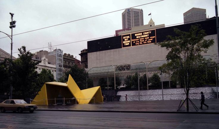 City Square, Melbourne (1980). Note the two significant items - the TV screen on the wall and the 'Yellow Peril' in the foreground