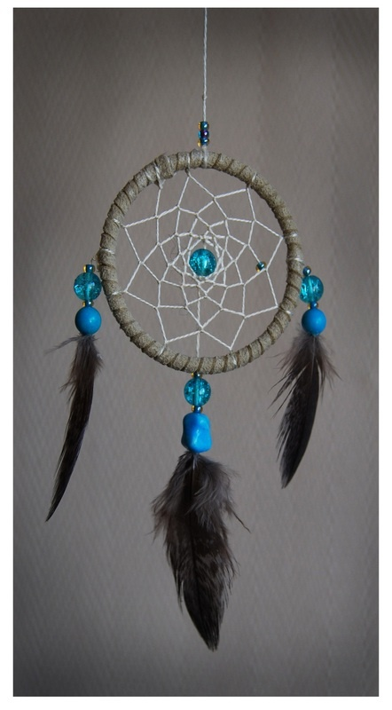 Small dreamcatcher made with turquoise, glass and feathers from norwegian free-range birds.  www.malinpettersen.com