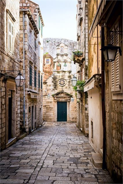 Narrow Street Inside Dubrovnik Old Town with Church on the End, Croatia