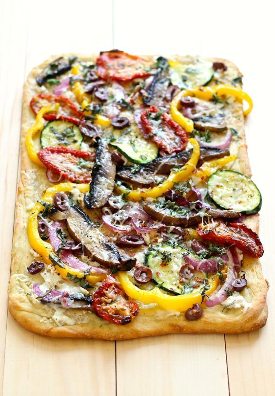 This Roasted Vegetable & Goat Cheese Flatbread is perfect for holiday entertaining