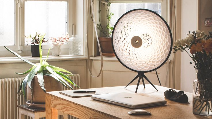 Swiss designer Jona Messerli has created a flat-pack table lamp with a lattice-patterned shade made from cut paper.