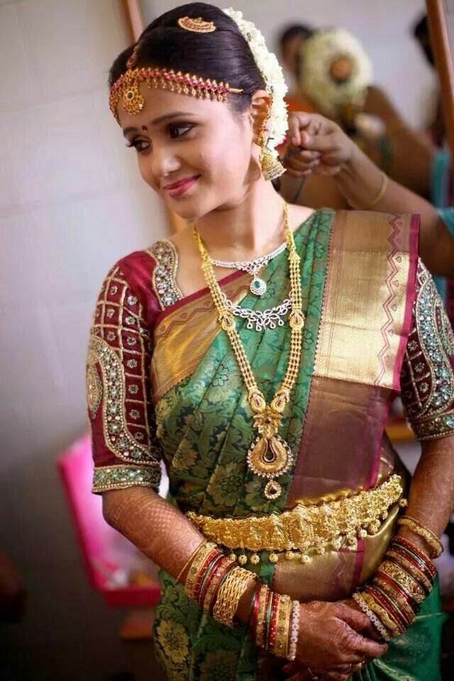 South Indian bride. Temple jewelry. Jhumkis.Red silk kanchipuram sari with contrast green blouse.Braid with fresh jasmine flowers. Tamil bride. Telugu bride. Kannada bride. Hindu bride. Malayalee bride.Kerala bride.South Indian wedding.