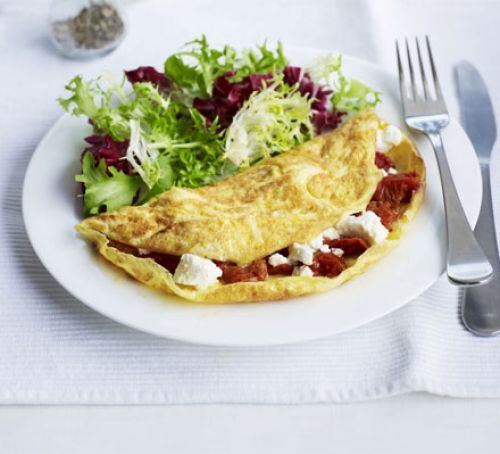 Feta & semi-dried tomato omelette is a super quick meal that's ready in 10 minutes.  A healthy and delicious omelette filled with tomato and feta cheese and served with a mixed salad.