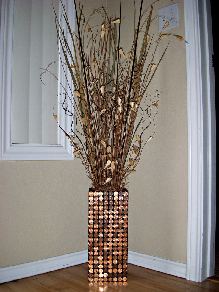 I made this Penny Vase for my mother for Christmas. I cut a 1x7 board, spray painted it black, glued the boards together to make a vase, and glued pennies on all 4 sides of the vase. Added the sticks and branches, then added some copper colored moss to tie it all together. This was such a fun DIY craft to do!