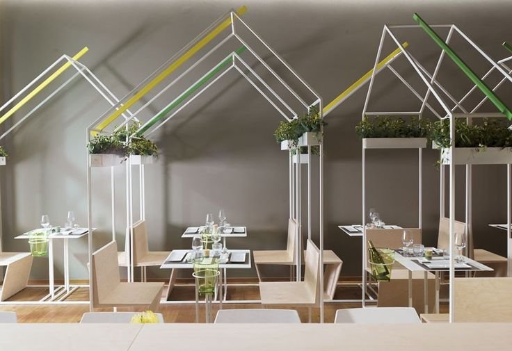 inside this restaurant, a series of house-shaped frames referencing the market stalls in tokyo to form the table and seating modules.