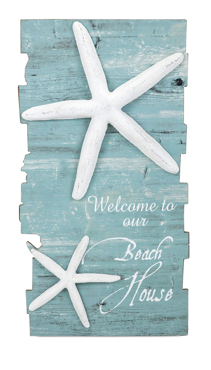 "Make any home your beach house with coastal decor. The ""Welcome to Our Beach House"" sign features a distressed blue finish and dimensional starfish accents. Dimensions: 39.5""h x 21""w x .5"""