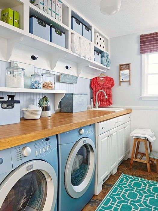 Beautiful blues in the laundry room. Love the solid wood countertop.