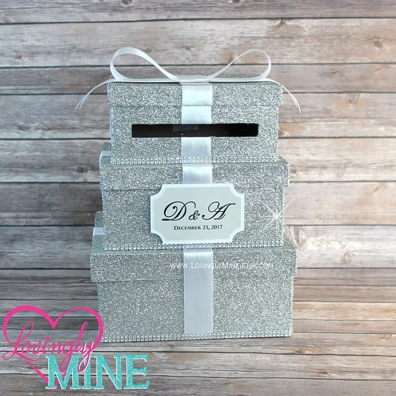 Card Box 3 Tier Fine Silver Glitter, Silver Rhinestones & White Satin Ribbon - Gift Money Box for Any Event - Additional Colors Available This listing is for 1 card holder box. The box is made of three tiers as shown hand dipped in glitter, sealed and accented with Baby Pink single face