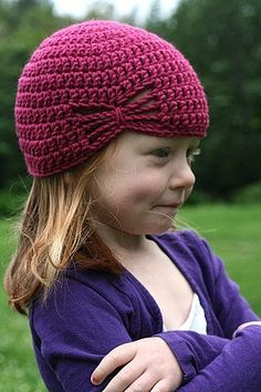 Crochet hat for little girls. Cute idea to skip 9-11 stitches, using chain stitches instead, then continuing on with double crochet on several rows, then tie center of those chains together for a