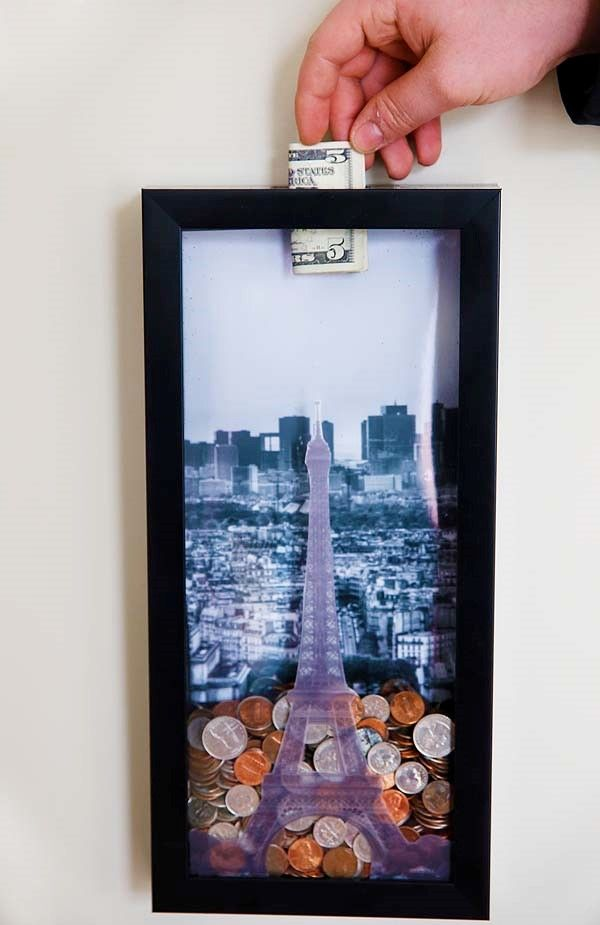 Create a money saving shadow box to save for that very special trip you dream of taking. We want to go to Paris! With only a few steps, you can create your very own and have a cute decoration to keep in your home while you save!
