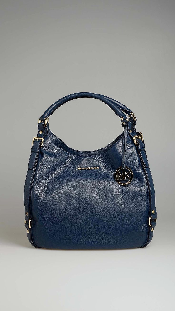 Michael Kors Bedford navy blue tote leather bag, center zip compartment, two compartment with snap button closure, five inside pockets