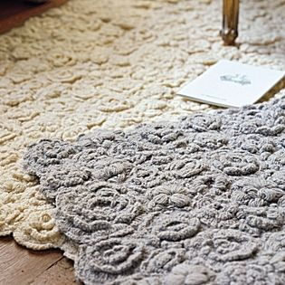 Natural Flora Crocheted RugDelicate but durable, this pretty rug reminds us of a vintage hand-knit sweater. The texture created by the all-over crocheted pattern is dense and cozy, bringing warmth and personality to the room.