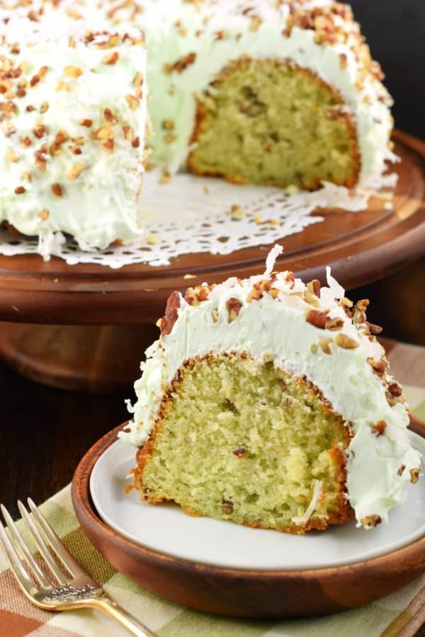 This Watergate Bundt Cake is nutty and moist thanks to pistachio pudding and pecans. Topped with a sweet, light whipped cream topping and coconut, this cake has it ALL!