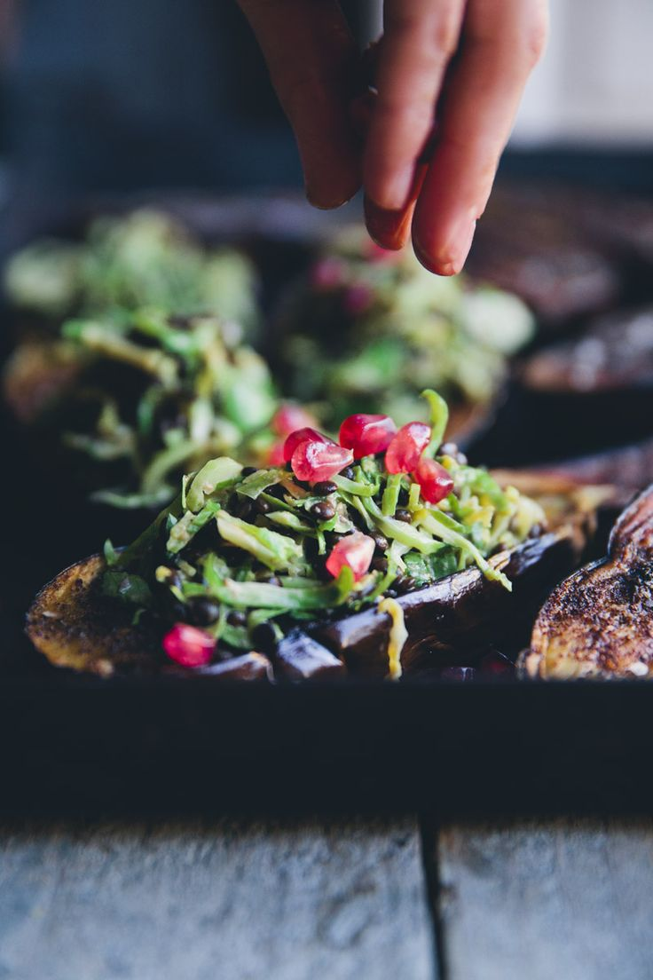Baked Aubergine with Brussels Sprout, Beluga & Pomegranate seen on Green Kitchen Stories