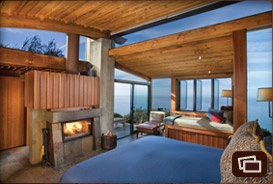 Big Sur. Ocean House  These single structures have curved, beamed roofs covered with a soft carpet of grass and wildflowers. There are panoramic ocean views from the bed, bath, window seat and terrace. The two-sided fireplace can be enjoyed from the bedroom and the shower and large soaking tub. A private deck overlooks the majestic ocean.