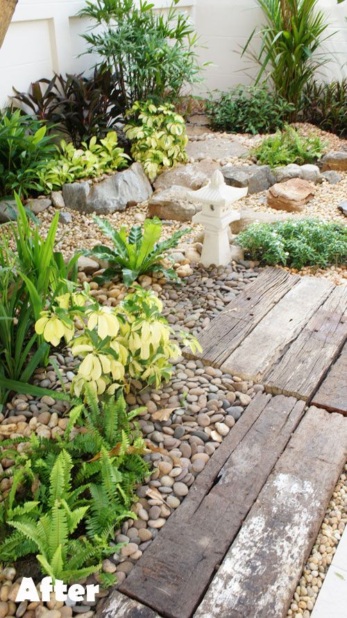 Dry Stream Garden: tropical plants, patterns made with rocks & pebbles, ornamental lighting, & wooden sleepers.