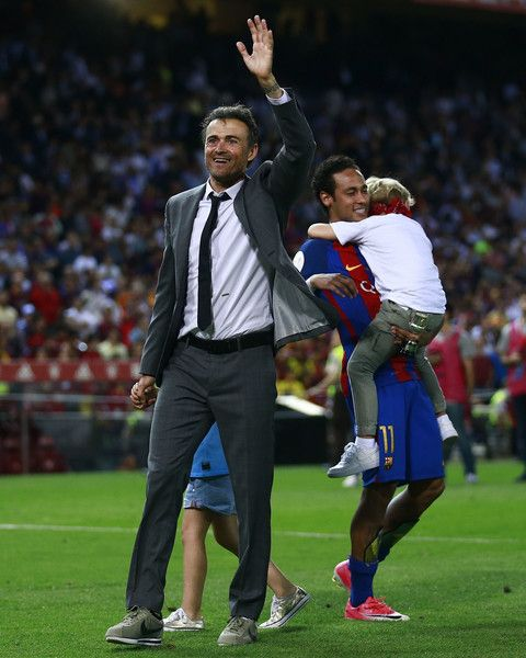 Head coach Luis Enrique Martinez of FC Barcelona celebrates ahead his player Neymar JR. after winning the Copa Del Rey Final between FC Barcelona and Deportivo Alaves at Vicente Calderon Stadium on May 27, 2017 in Madrid, Spain.