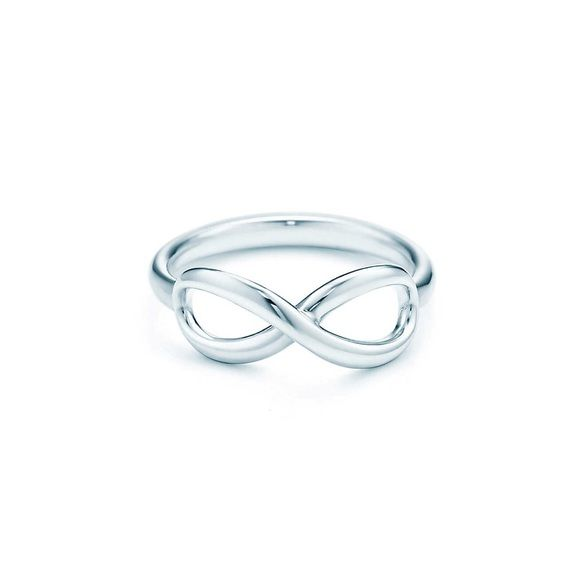 Tiffany Infinity Ring in Sterling Silver  TIFFANY & CO.  Infinity Ring.    Sterling Silver.   excellent condition. with its original box & bag.    size 6    no trade   no PP. price is firm    ask questions .     More photos upon requests. Tiffany & Co. Jewelry Rings