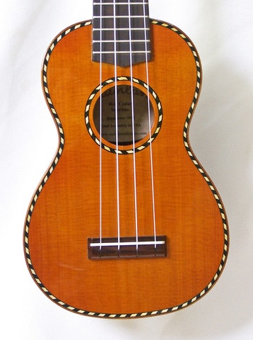 This sweet sounding soprano ukulele features a solid cedar top, a solid rosewood body, gloss finish, genuine bone nut & saddle, rosewood fretboard & bridge and sealed gear tuners.