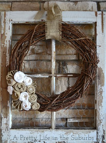 old window pane or frame, willow branch natural wreath, add fabric flowers, burlap ribbon, chicken wire.