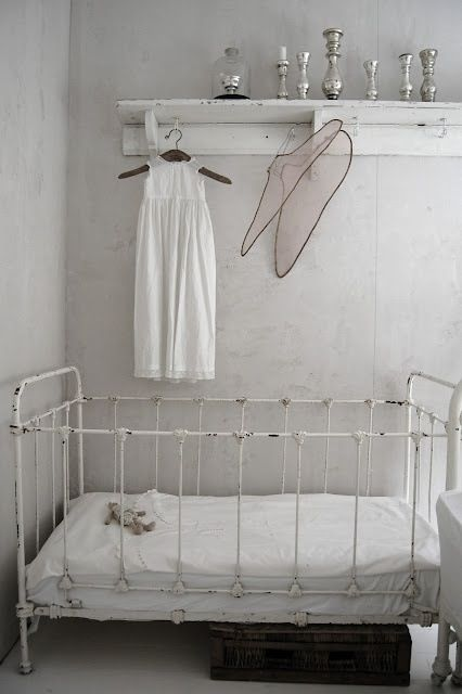 Cute iron crib, not useful for today, but modified would make a cute daybed