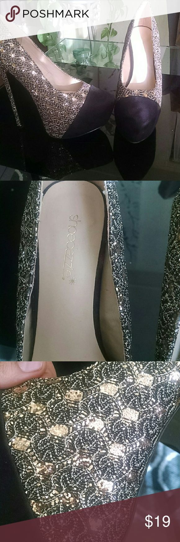 Shoe dazzle High heels Beautiful black and gold high heel/ stilettos from shoe dazzle there in a great condition! I've only used them once for a wedding as a bridesmaid Shoe Dazzle Shoes Heels