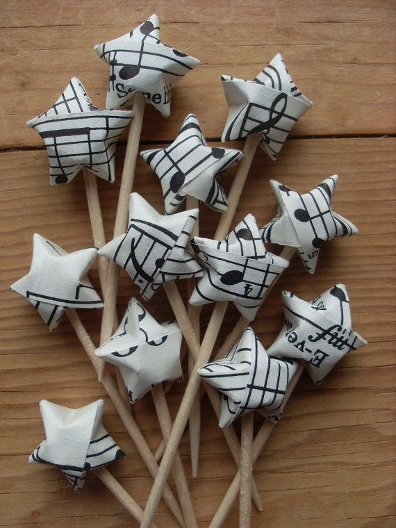 Vintage Sheet Music Party Picks, Upcycled Origami Stars, set of 12. Would be cute with any paper that fit your theme, although labor-intensive. You could make them while watching tv, though.
