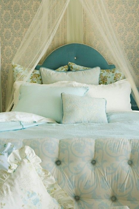 Cozy blue bed that I just want to fall into. All the fluffy pillows are a must.