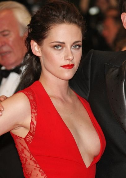 """Kristen Stewart in a red dramatic Reem Acra dress with a very plunging neckline at the 2012 premiere of """"Cosmopolis"""" in Cannes."""