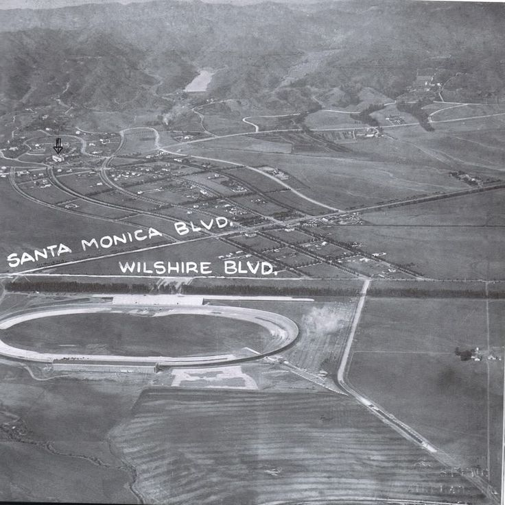 Without photos like these, it's hard to conceive of a time when Beverly Hills and its environs were largely rural. This was taken in 1920 and shows us how little this area was developed. Toward the top of the photo over to the left, you can see a black hand-drawn arrow – that's the Beverly Hills Hotel. The large oval structure is the Los Angeles Speedway – aka the Beverly Hills Speedway (1919 to 1924.) It was a good location—there were hardly any neighbors disturbed by the noise!