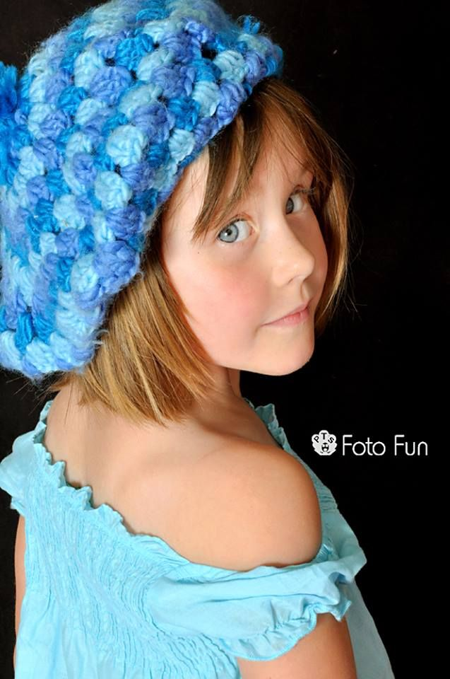 Stunning blue eyed girl in blue clothes and blue hat