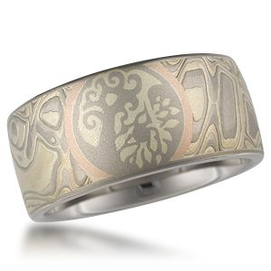Mokume Tree of Life Symbol Wedding Band - This mokume wedding band is inlaid with a Tree of Life symbol and framed in with rose gold. Please inquire for pricing for other symbols.