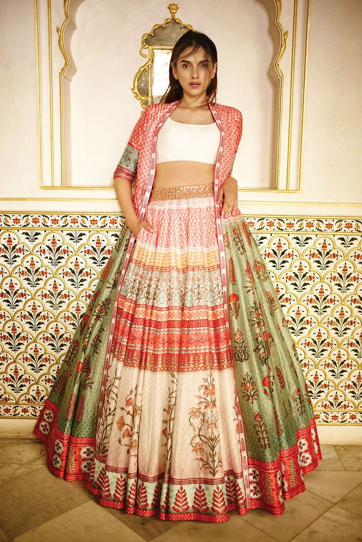 Presenting a beautiful composition of a mid-tone floral, digital printed lehenga paired with a chanderi silk jacket and a solid ivory blouse. INR 80,000.00