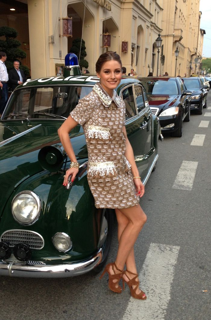 Hi everyone!  This photo of me and Johannes is taken in Munich, Germany before attending the opening of the Louis Vuitton store.  My dress is Louis Vuitton (see simliar versions per Moschino,  Rochas, and Maxmara).  See a similar version of my shoes here.  Have a wonderful day!  oliviapalermo.com