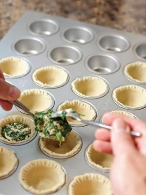 Press each pie crust circle into the mini muffin pan, and use a fork to flute the edges at the top. Fill each mini pie with the quiche filling to just below the top of the pie crust. Bake for 20-25 minutes.