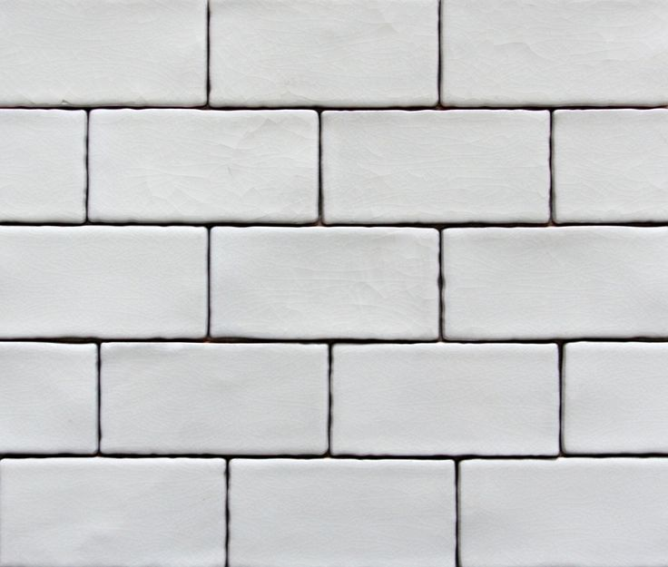 Glazed wall tiles with a lovely glossy crackle through them - rustic edge given a handmade feel - contemporary with a traditional feel