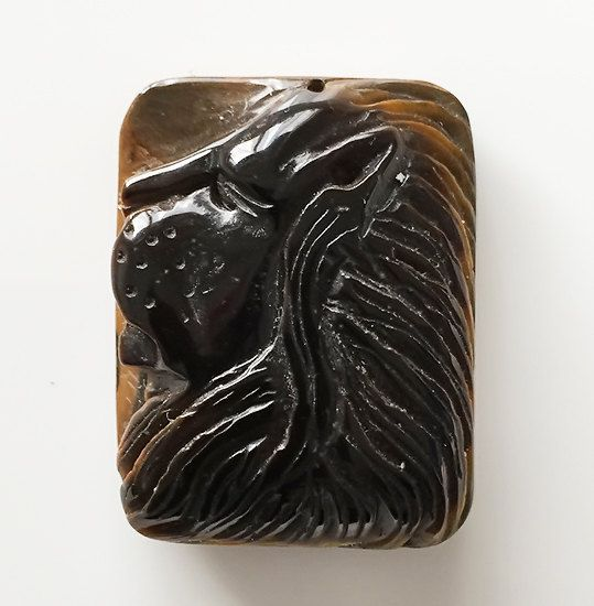 A Gorgeous Australian Tiger Eye Carved Lion's head Focal Pendant Artisan work by StarryPath on Etsy