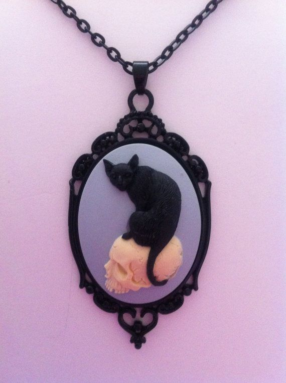 Black Cat on a Skull Cameo Necklace (goth, punk, psychobilly, rockabilly, spooky, steampunk, alternative, hipster) via Etsy