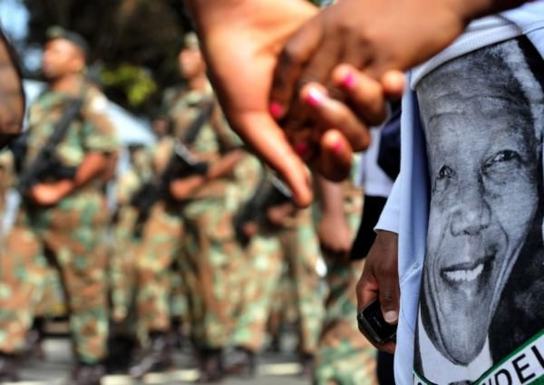 Remembering Madiba | Bystanders watch as members of South African Defence Force march from the Union Buildings. Photo: Thobile Mathonsi/Pretoria News