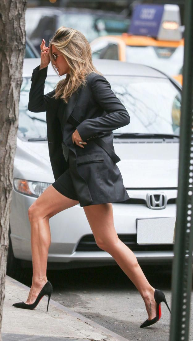 Jennifer Aniston leggy in a little black mini dress, blazer and pumps