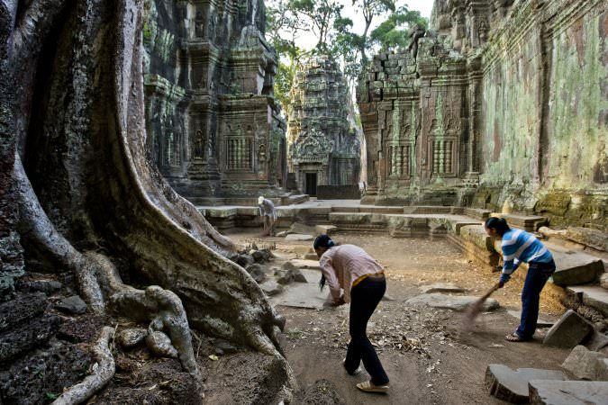 <p>The ultimate Indiana Jones fantasy, Ta Prohm is cloaked in dappled shadow, its crumbling towers and walls locked in the slow muscular embrace of...